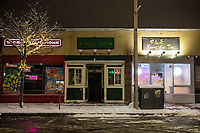 """The darkened front door and sign of Sligo Pub is seen in Davis Square as the bar is temporarily closed in hibernation due to the ongoing Coronavirus (COVID-19) global pandemic in Somerville, Massachusetts, on Tue., Jan. 26, 2021. The pub, which does not have its own kitchen, closed on Oct. 30, after weeks of operating out on its back patio in partnership with nearby Dragon izzastating on Facebook: """"Due to Covid numbers rising and this shit weather we have decided to not open today and unfortunately tomorrow...We value the safety of our customers and look forward to seeing you when we reopen in March!! We're so thankful for Charlie and Dragon Pizza for teaming up with us to make this awesome patio happen. Thanks to all our loyal friends for supporting us these past three months! All your generosity has helped us going forward! Thanks to the City of Somerville for taking a chance and helping a family owned business get through this challenging time. We love you all and look forward to partnering with Dragon Pizza in March!"""""""