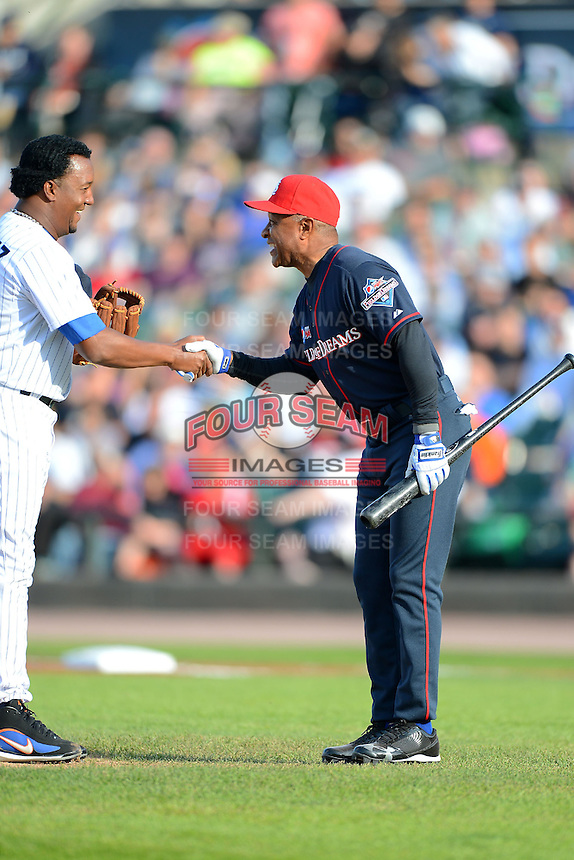 Hall of Fame shortstop Ozzie Smith #1 shakes hands with Pedro Martinez #45 during the MLB Pepsi Max Field of Dreams game on May 18, 2013 at Frontier Field in Rochester, New York.  (Mike Janes/Four Seam Images)