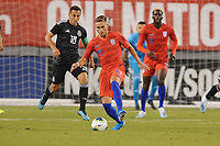 EAST RUTHERFORD, NJ - SEPTEMBER 7: Tyler Boyd #21 of the United States battles for the ball with Andres Guardado #18 of Mexico during a game between Mexico and USMNT at MetLife Stadium on September 6, 2019 in East Rutherford, New Jersey.