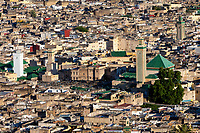 Fes, Morocco.  Old City (Fes El-Bali), Kairaouine Mosque (on left, with white minaret), Zawiya of Moulay Idris (center, with tiled minaret).