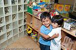 Education Preschool 3-5 year olds two friends boys hugging horizontal
