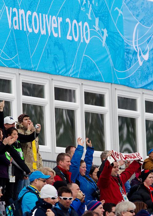 Vancouver 2010 - Para Nordic Skiing // Ski paranordique.<br /> Alexei Novikov and guide Jamie Stirling compete in Para Nordic Skiing // Alexei Novikov et son guide Jamie Stirling concourent en ski paranordique. 15/03/2010.