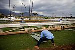 September 27 2014: Track maintenance crew members rush to move the temporary rail for turf racing at Santa Anita Park in Arcadia CA. Alex Evers/ESW/CSM