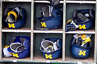 Michigan Wolverines helmet rack before Game 1 of the NCAA College World Series against the Texas Tech Red Raiders on June 15, 2019 at TD Ameritrade Park in Omaha, Nebraska. Michigan defeated Texas Tech 5-3. (Andrew Woolley/Four Seam Images)