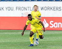 FOXBOROUGH, MA - OCTOBER 3: Tah Brian Anunga #27 of Nashville SC brings the ball forward during a game between Nashville SC and New England Revolution at Gillette Stadium on October 3, 2020 in Foxborough, Massachusetts.