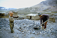 Children at work in Chacaltaya Road, Bolivia - Child labor as seen around the world between 1979 and 1980 - Photographer Jean Pierre Laffont, touched by the suffering of child workers, chronicled their plight in 12 countries over the course of one year.  Laffont was awarded The World Press Award and Madeline Ross Award among many others for his work.