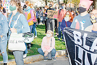 A crowd gathers in Boston Common for the 2020 Women's March protest in opposition to the re-election of US president Donald Trump in Boston, Massachusetts, on Sat., Oct. 17, 2020.