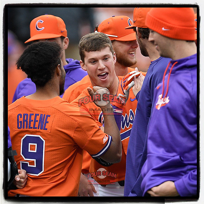Right fielder Michael Green (11) of the Clemson Tigers is swamped by teammates after hitting a home run in a game against the South Alabama Jaguars on Opening Day, Friday, February 15, 2019, at Doug Kingsmore Stadium in Clemson, South Carolina. Clemson won, 6-2. (Tom Priddy/Four Seam Images)
