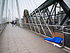 Homeless person sleeping on Hungerford Bridge in the rain.<br />