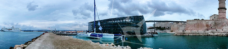The Maxi Trimaran Solo Banque Populaire VII (FRA), the 103 feet trimaran skippered by Armel Le Cléac'h in front of the Mucem (Museum for Europe and the Mediterranean), Marseille, France.