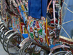 Cycle rickshaws are an affordable means of local transport throughout Asia. It is a difficult job for the rickshaw driver. Many rickshaw wallahs come from villages outside the city, and sleep in their rickshaws at night.