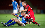 St Johnstone v St Mirren...20.09.11   Scottish Communities League Cup Third Round.Jamie Adams gets booked for this challenge on Marc McAusland.Picture by Graeme Hart..Copyright Perthshire Picture Agency.Tel: 01738 623350  Mobile: 07990 594431