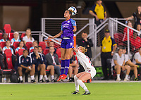 WASHINGTON, DC - AUGUST 24: Carson Pickett #16 of the Orlando Pride goes up for a header with Tori Huster #23 of the Washington Spirit during a game between Orlando Pride and Washington Spirit at Audi Field on August 24, 2019 in Washington, DC.