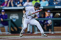 Vanderbilt Commodores outfielder Rhett Wiseman (8) reacts to being hit by a pitch in the throat against the TCU Horned Frogs in Game 12 of the NCAA College World Series on June 19, 2015 at TD Ameritrade Park in Omaha, Nebraska. The Commodores defeated TCU 7-1. (Andrew Woolley/Four Seam Images)