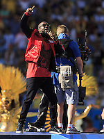 Wyclef Jean performs during the closing ceremony