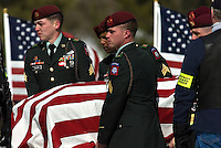 Members of an honor guard from the US Army's Third Brigade of the 82nd Airborne Division deliver the casket of their fellow soldier, Eric O'Hara, before a funeral service at Fort Logan National Cemetery in Denver on Thursday afternoon.