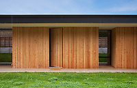 The exterior, like the interior, of this modern house is clad in pine