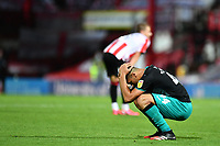 Ben Cabango of Swansea City looks dejected at full time during the Sky Bet Championship Play Off Semi-final 2nd Leg between Brentford and Swansea City at Griffin Park in Brentford, England, UK. 29th July, 2020