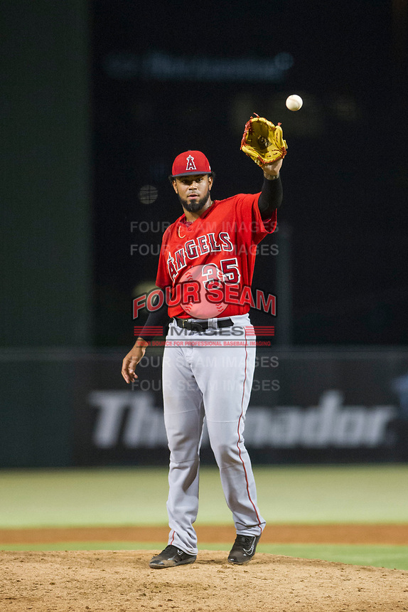 AZL Angels relief pitcher Kida De La Cruz (35) receives a new ball during a game against the AZL Indians on August 7, 2017 at Tempe Diablo Stadium in Tempe, Arizona. AZL Indians defeated the AZL Angels 5-3. (Zachary Lucy/Four Seam Images)