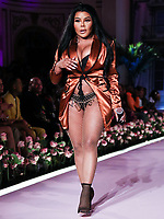 MANHATTAN, NEW YORK CITY, NEW YORK, USA - SEPTEMBER 08: Rapper Lil' Kim performs onstage at the PrettyLittleThing x Saweetie runway show during New York Fashion Week: The Shows held at The Plaza Hotel on September 8, 2019 in Manhattan, New York City, New York, United States.