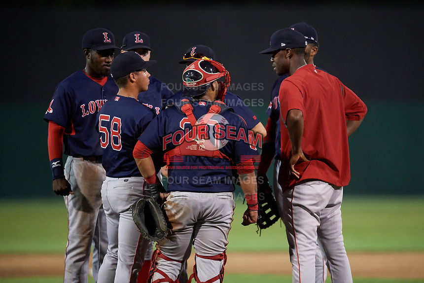Lowell Spinners pitching coach Nick Green (23) talks with (clockwise) catcher Alberto Schmidt (20), relief pitcher Oddanier Mosqueda (58), third baseman Xavier LeGrant (15), shortstop Korby Batesole (12), second baseman Grant Williams (11), and first baseman Trey Ganns (28) during a game against the Auburn Doubledays on July 13, 2018 at Falcon Park in Auburn, New York.  Lowell defeated Auburn 8-5.  (Mike Janes/Four Seam Images)