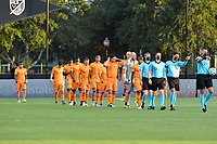 LAKE BUENA VISTA, FL - JULY 18: The starting XI from the Houston Dynamo and referees enter the field wearing masks during a game between Houston Dynamo and Portland Timbers at ESPN Wide World of Sports on July 18, 2020 in Lake Buena Vista, Florida.