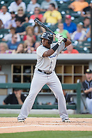 Carlos Moncrief (34) of the Columbus Clippers at bat against the Charlotte Knights at BB&T BallPark on May 27, 2015 in Charlotte, North Carolina.  The Clippers defeated the Knights 9-3.  (Brian Westerholt/Four Seam Images)