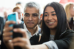 © Joel Goodman - 07973 332324 . 27/09/2016 . Liverpool , UK . London mayor SADIQ KHAN poses for a selfie with a supporter at the ACC conference centre on the third day of the Labour Party Conference at the ACC in Liverpool . Photo credit : Joel Goodman