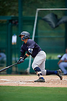 GCL Yankees West designated hitter Antonio Cabello (25) follows through on a swing during the second game of a doubleheader against the GCL Braves on July 30, 2018 at Champion Stadium in Kissimmee, Florida.  GCL Braves defeated GCL Yankees West 5-4.  (Mike Janes/Four Seam Images)