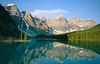 Sunrise at Moraine Lake with mirrow reflection of the rugged peaks. Moraine Lake is in the Valley of the Ten Peaks in Banff National Park, Alberta, Canada