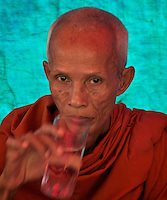 Buddhist Monk near Aek Phnom Angkorian Temple, a local funeral ceremony in a Village near Battambang Cambodia,