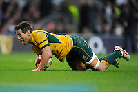 Bernard Foley of Australia dives over to score a try during the QBE International match between England and Australia at Twickenham Stadium on Saturday 29th November 2014 (Photo by Rob Munro)