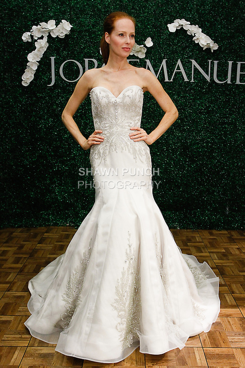 Model poses in a Verbena bridal gown from the Jorge Manuel Haute Couture Fleur Collection 2014, during Couture Bridal Fashion Week, on October 12, 2013.