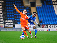 Blackpool's Oliver Turton vies for possession with Peterborough United's Siriki Dembele<br /> <br /> Photographer Chris Vaughan/CameraSport<br /> <br /> The EFL Sky Bet League One - Peterborough United v Blackpool - Saturday 21st November 2020 - London Road Stadium - Peterborough<br /> <br /> World Copyright © 2020 CameraSport. All rights reserved. 43 Linden Ave. Countesthorpe. Leicester. England. LE8 5PG - Tel: +44 (0) 116 277 4147 - admin@camerasport.com - www.camerasport.com