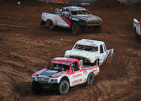 Mar. 20, 2011; Chandler, AZ, USA;  LOORRS pro lite driver Rodrigo Ampudia leads Corey Sisler in turn 3 during round two at Firebird International Raceway. Mandatory Credit: Mark J. Rebilas-