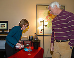 """Rebecca Davidson pours wine for Dan Carrick during the Reno Magazine """"Bubbles Tasting"""" event at Total Wine in Reno on Friday night, February 9, 2018."""