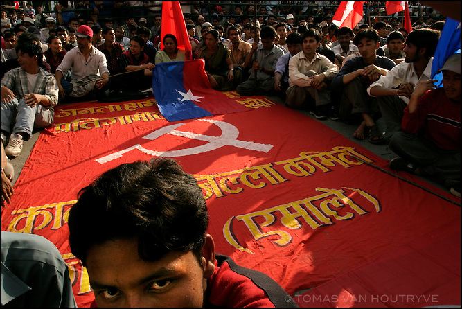 Protesters gather around a communist flag during an anti-government political rally in Kathmandu, Nepal on 2 June, 2004.<br />