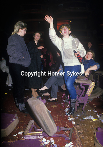 Pop Concert 1980s live performance gig in Glasgow. Fans screaming they have smashed up the seating, furniture at a pop music concert. Pop group are called Big Country on tour Scotland 80s