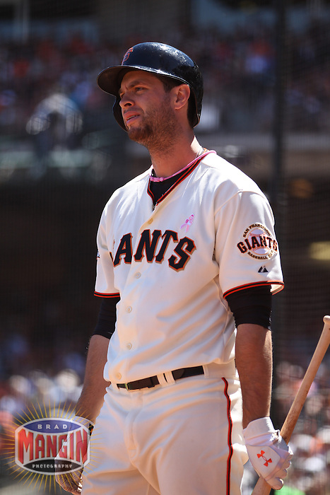 SAN FRANCISCO, CA - MAY 12:  Brandon Belt #9 of the San Francisco Giants waits in the on deck circle against the Atlanta Braves during the game at AT&T Park on Sunday, May 12, 2013 in San Francisco, California. Photo by Brad Mangin