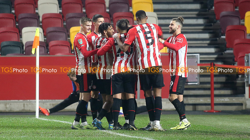 Brentford players congratulate Josh DaSilva after scoring their opening goal during Brentford vs Newcastle United, Carabao Cup Football at the Brentford Community Stadium on 22nd December 2020