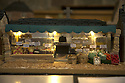 """08/12/16<br /> <br /> Peak Feast shop (cake just shows counter as building doesn't look like a shop)<br /> <br /> In this incredibly detailed replica of a small Peak District village, everything is edible, from the baubles on the Christmas trees to the flowers around the houses and what's more the """"village"""" is made from 35 individual rich fruit Christmas cakes which will be eaten on the 25th!<br /> <br /> The amazing model village is made up of 18 shops and houses, which are all realistic reproductions of the actual buildings found in Youlgreave, and is open to the public to view at All Saints' church, the main focal point of the miniature masterpiece.<br /> <br /> Retired florist Lynn Nolan, who decorated all the cakes, came up with the original idea as a way of raising money for the church, which needs a new roof, and the first of the cakes went in the oven back in April.<br /> <br /> MORE...https://fstoppressblog.wordpress.com/the-village-thats-really-a-christmas-cake/<br /> <br /> All Rights Reserved F Stop Press Ltd. (0)1773 550665   www.fstoppress.com"""