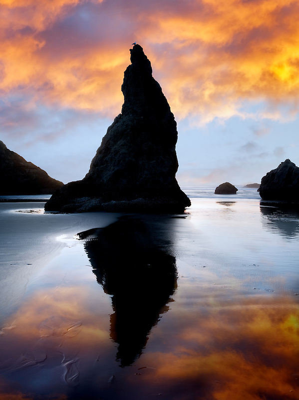 Rocks at Bandon with reflection at sunset. Oregon