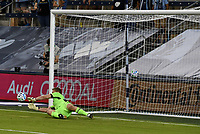 KANSAS CITY, KS - OCTOBER 07: #29 Tim Melia of Sporting Kansas City stops the penalty kick taken by #27 Robert Beric of Chicago Fire FC in the opening minutes of the match during a game between Chicago Fire and Sporting Kansas City at Children's Mercy Park on October 07, 2020 in Kansas City, Kansas.