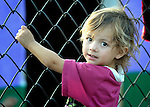 A child hangs on to a fence in the largely Roma neighborhood of Gorno Ezerovo, part of the Bulgarian city of Burgas. Residents here don't self-identify much as Roma, because of the negative connotations associated with the word, so many refer to themselves as a Turkish-speaking minority.