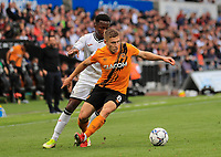 11th September 2021; Swansea.com Stadium, Swansea, Wales; EFL Championship football, Swansea versus Hull City; Greg Docherty of Hull City controls the ball while under pressure from Ethan Laird of Swansea City