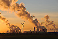 Wind turbine in front of Drax Power Station at sunset.The largest coal powered plant in UK, Goole, North Humberside.