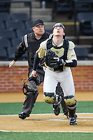 Wake Forest Demon Deacons catcher Garrett Kelly (28) chases after a foul pop fly during the game against the Marshall Thundering Herd at Wake Forest Baseball Park on February 17, 2014 in Winston-Salem, North Carolina.  The Demon Deacons defeated the Thundering Herd 4-3.  (Brian Westerholt/Four Seam Images)