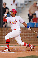 First baseman Osvaldo Morales (37) of the Johnson City Cardinals follows through on his swing at Howard Johnson Field in Johnson City, TN, Thursday July 3, 2008.