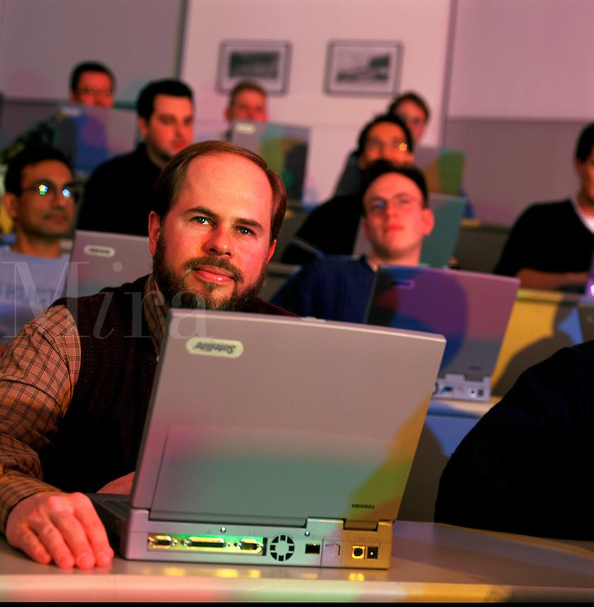 Graduate students using laptop computers