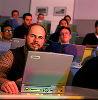 Graduate students using laptop computers